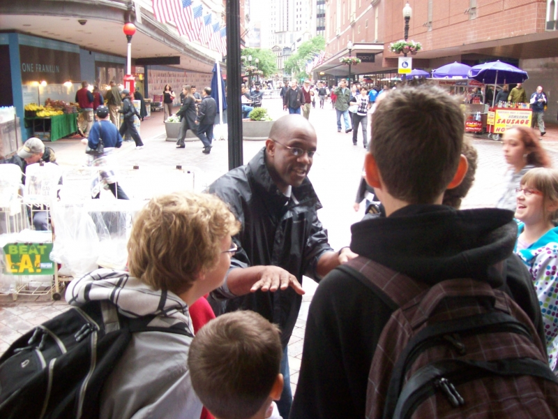 Robert shares with a bunch of kids on the streets of downtown Boston.