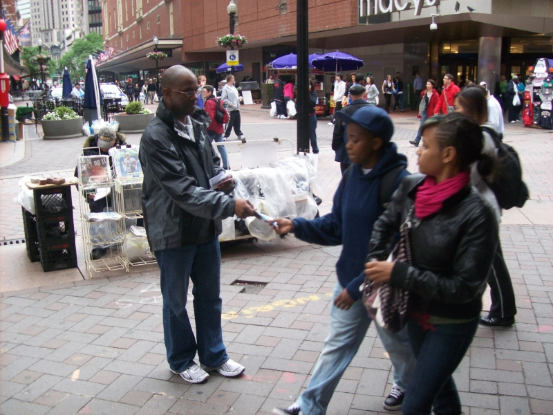 Robert handing out gospel tracts.