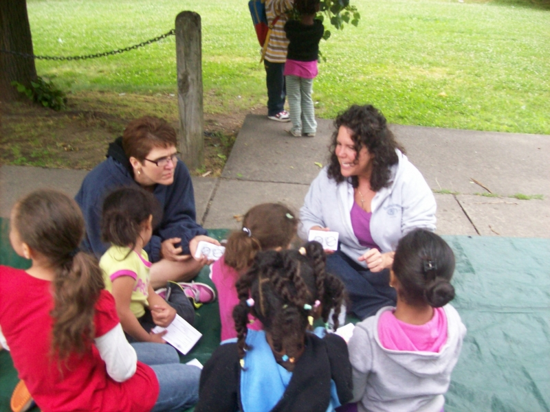 Glenda and Nicole talking with some girls after a kids meeting.