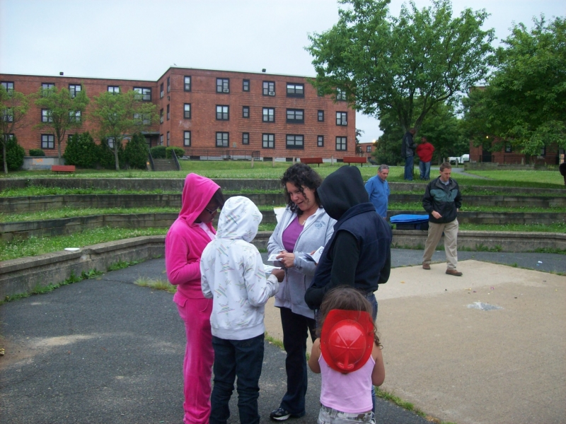 Nicole walking some children through a gospel booklet after a meeting.