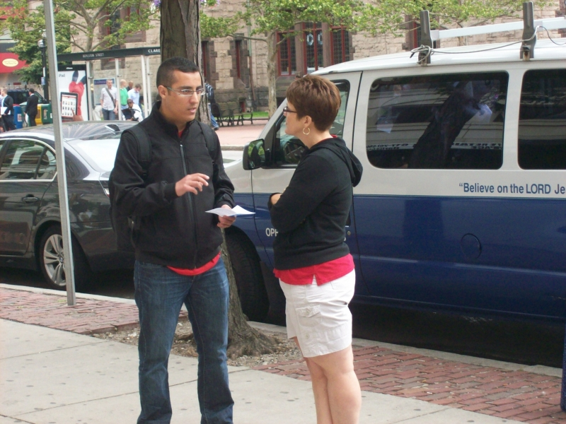Glenda witnessing to a young man who had questions.