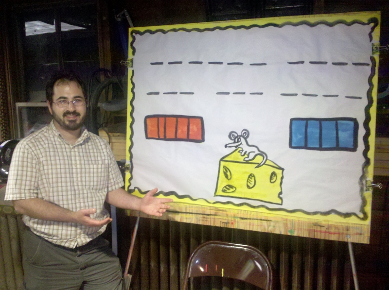 My hangman puzzle. This is \'Mark the Mouse\' and I told the kids that the cheese was MY dinner and since the mouse had the same name as me, the mouse wanted to eat MY dinner. Every time they got a letter wrong, the mouse would take a bite, so I begged the kids not to let Mark the Mouse eat my cheese. They loved it and giggled. I sent this photo to my Pastor, Juan, and he said the mouse looked like an elephant. I think Juan is a bit loco!