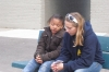 Paula sharing the gospel with a young girl after a meeting.