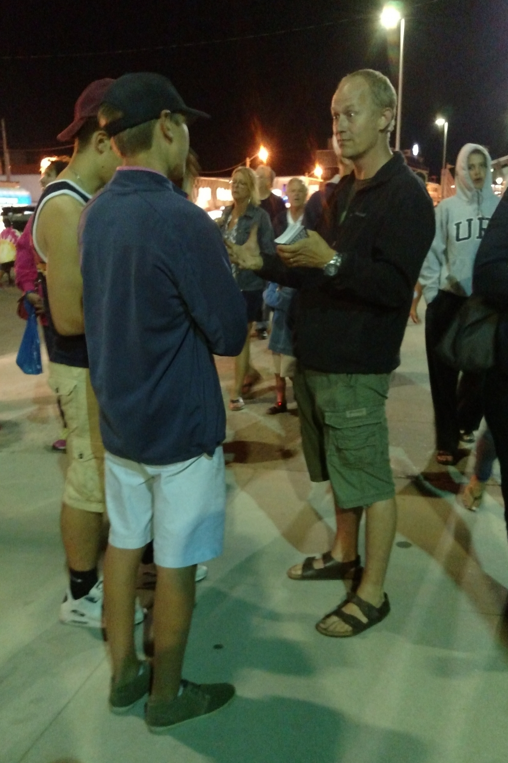 After messages, it's common for people to come ask us questions. We invite this! Here Chris is sharing the gospel with a stranger who God sent our way.
