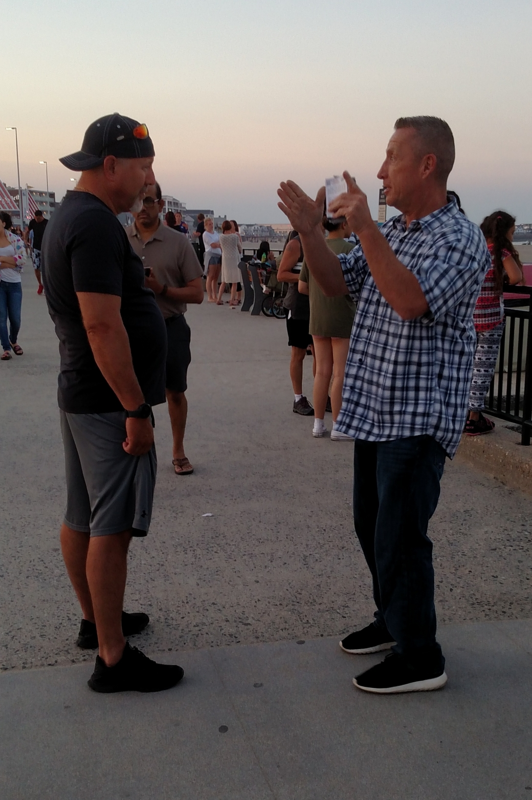 """Paul (right) is a faithful volunteer and gifted Evangelist. Paul skillfully diffused this heckler who came by to make fun of the painting. Paul overcame """"evil with good"""" (Romans 12:21) and through his kindness, got into a fruitful conversation with this man. Praise God!"""
