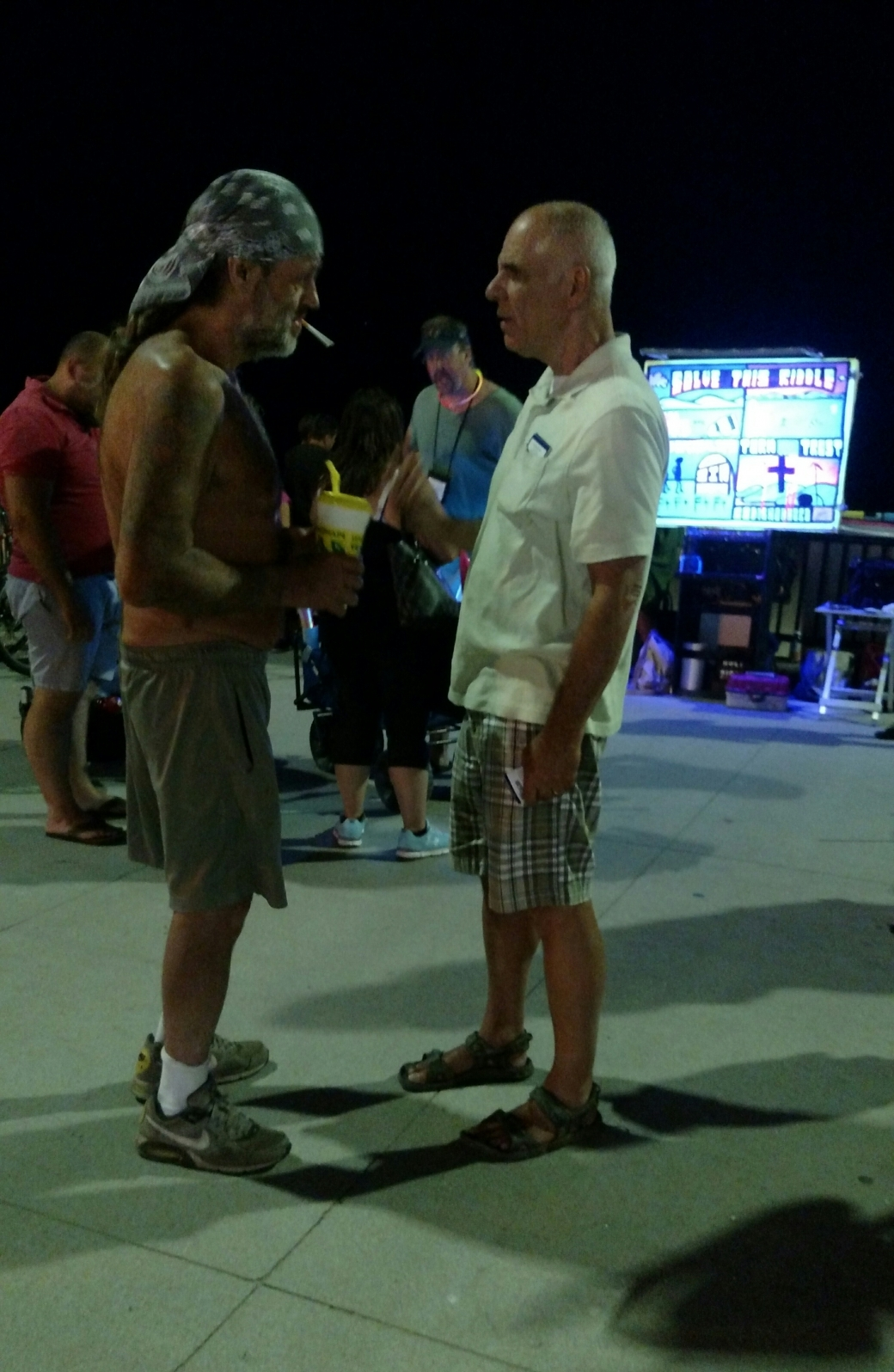 Eric (right) patiently answered the questions of this man.