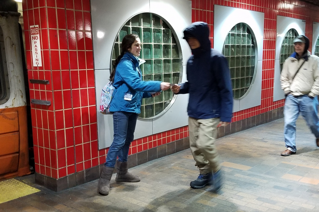 Ellie is showing how easy it is to give out a gospel tract to a stranger. Just smile and hold it out. Easy!