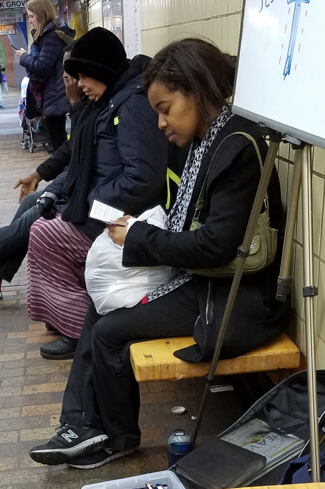 This woman sat and read through one of the more than 1,000 gospel tracts given out. Yay!