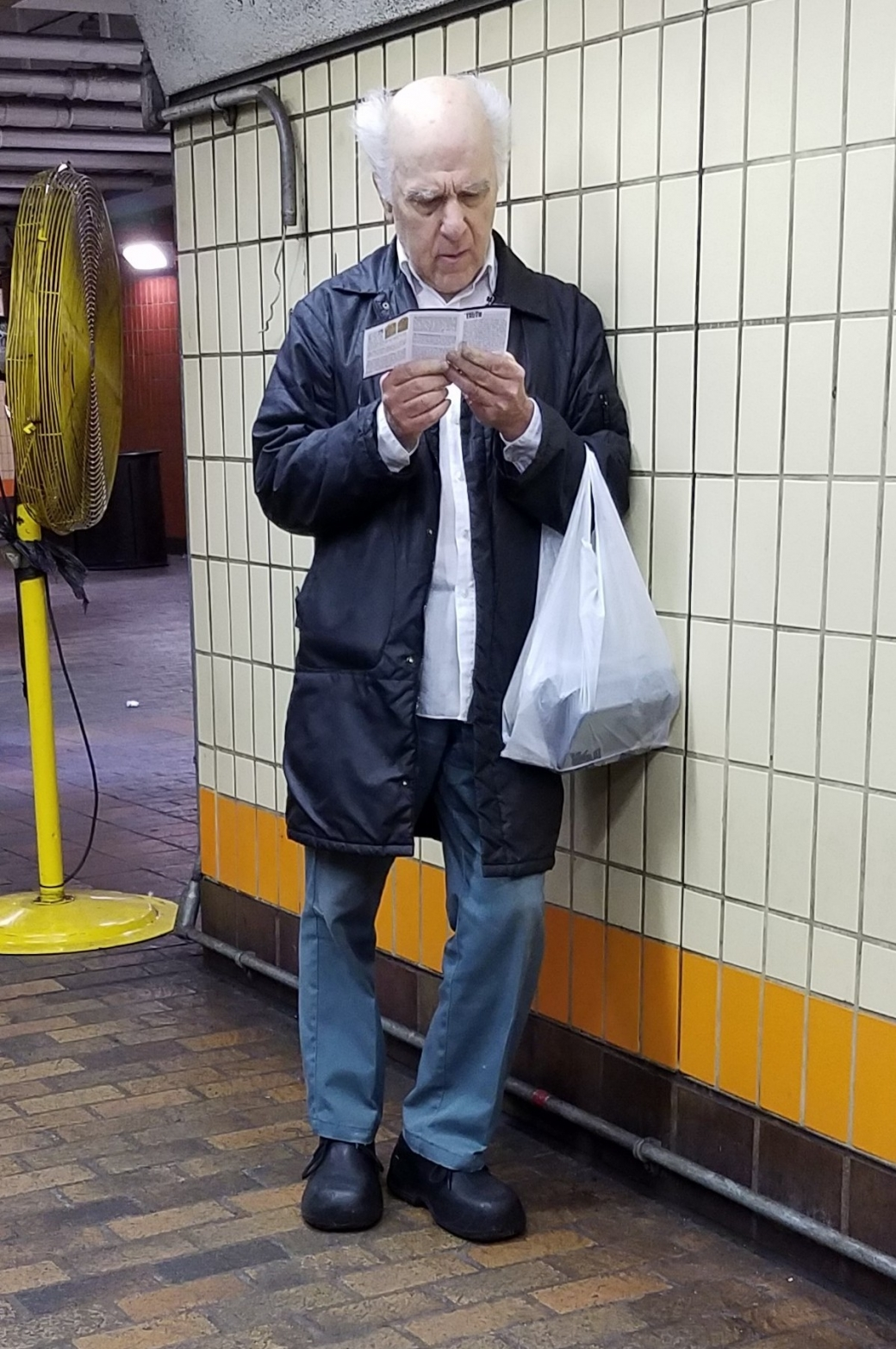This gentleman was reading the tract with a lot of focus. I tried to start up a conversation with him, but sadly he wasn't interested in that. But at least he read the gospel booklet!