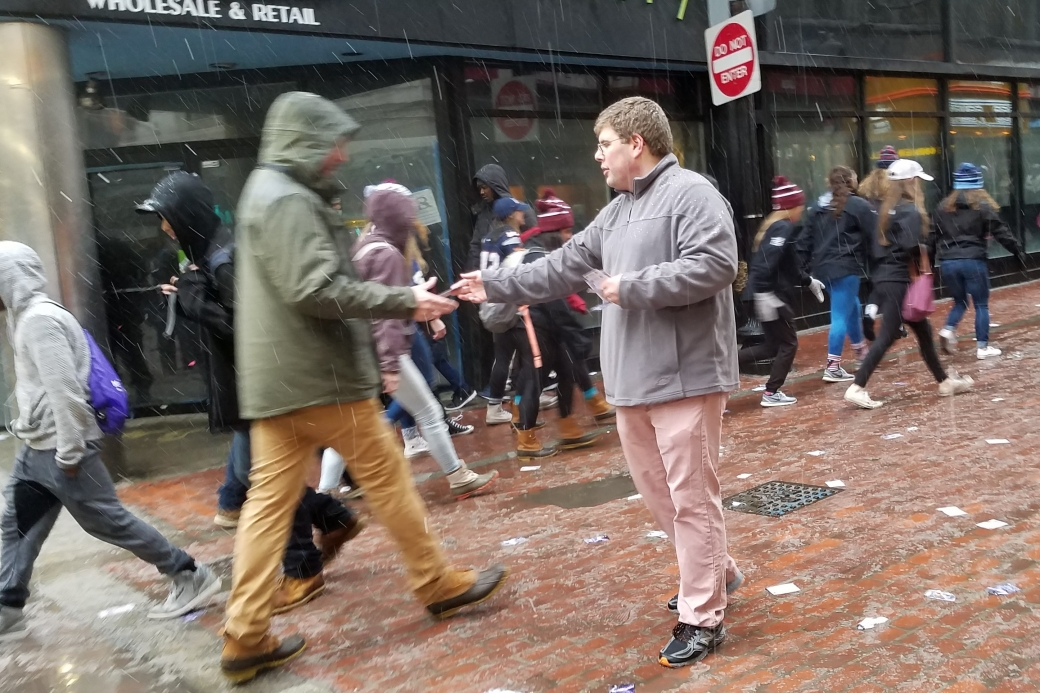 John handing out gospel tracts. You can see the snow coming down.