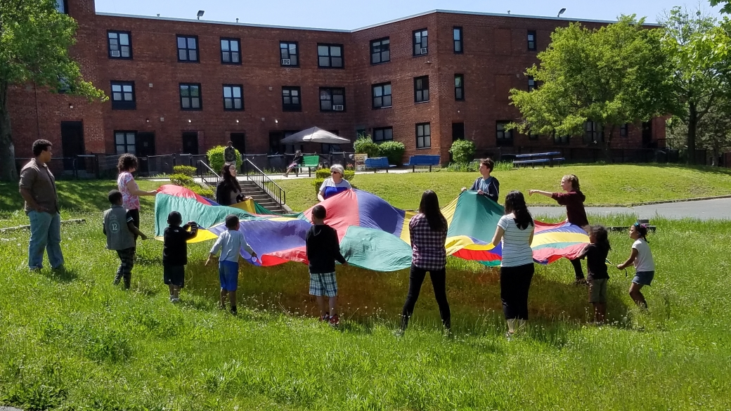 More often kids are not outside, preferring to play on electronics inside their apartments. So we've been having a fun game-time first to get the attention of the kids and make them want to come outside. This parachute game did a great job having the kids come outside to join the free Kid's Bible Club!