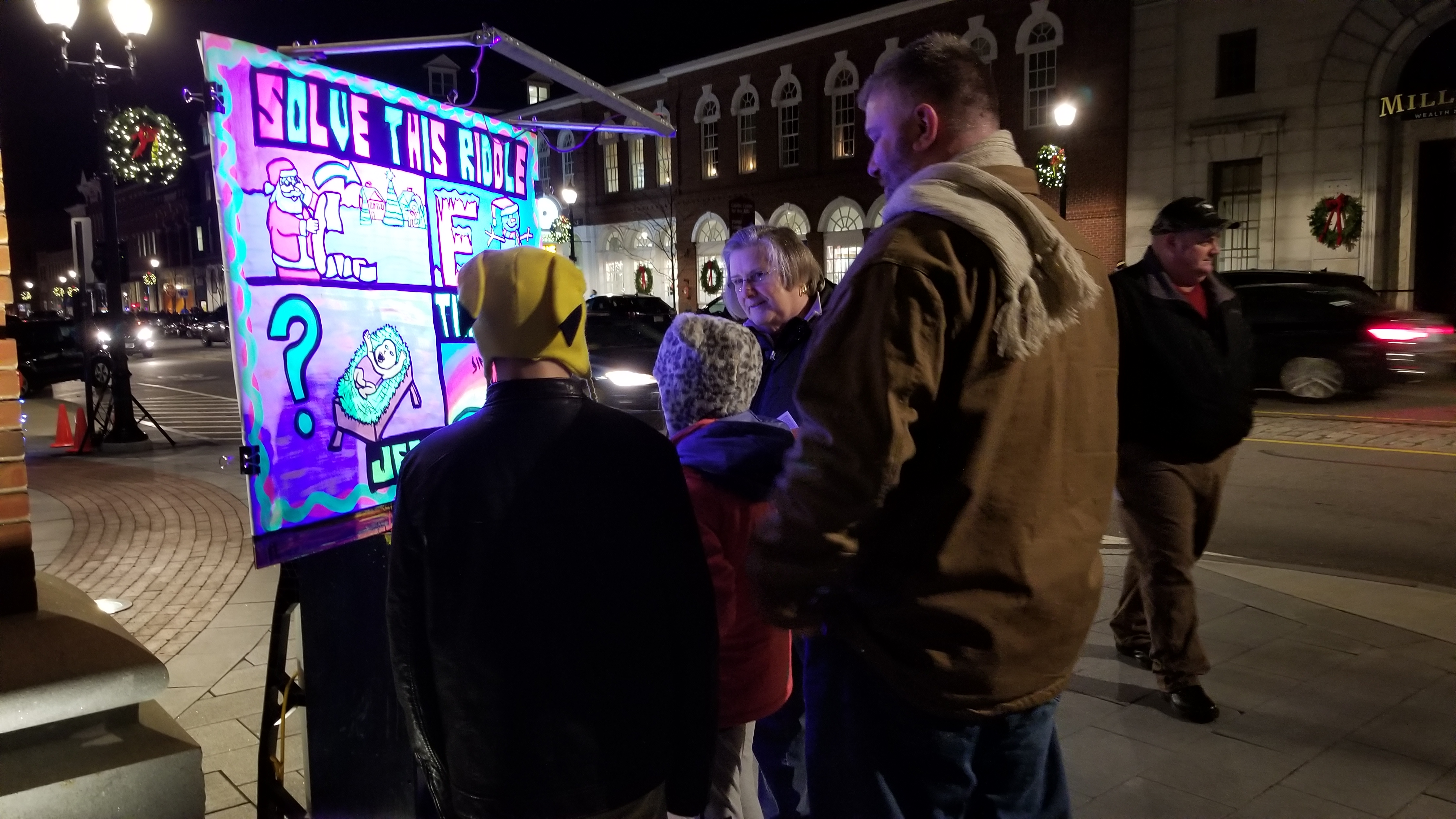 Our State Capitol, Concord, NH, had its annual 'Midnight Merriment' event and tons of people came out for it. Our Christmas-themed fluorescent riddles got us intro loads of fruitful gospel conversations, like this one with this friendly family. Was it cold that night? Oh yeah! But worth it!!!