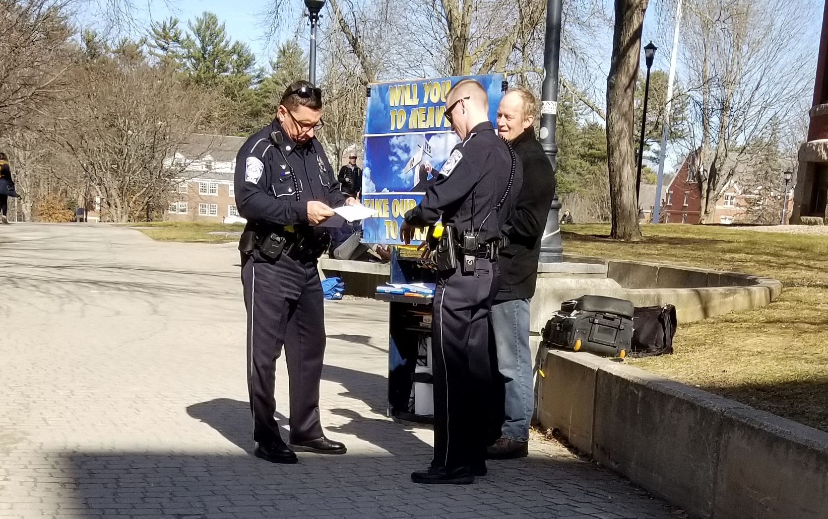We had an unseasonably warm day at the end of February, so we headed to the University of New Hampshire. Over 600 gospel booklets were given out! Someone called the Police on us, but the Officers were very polite and let us continue our ministry work unhindered. You can see the Policeman on the left checking out our permit. We thank Jesus for favor with the authorities!