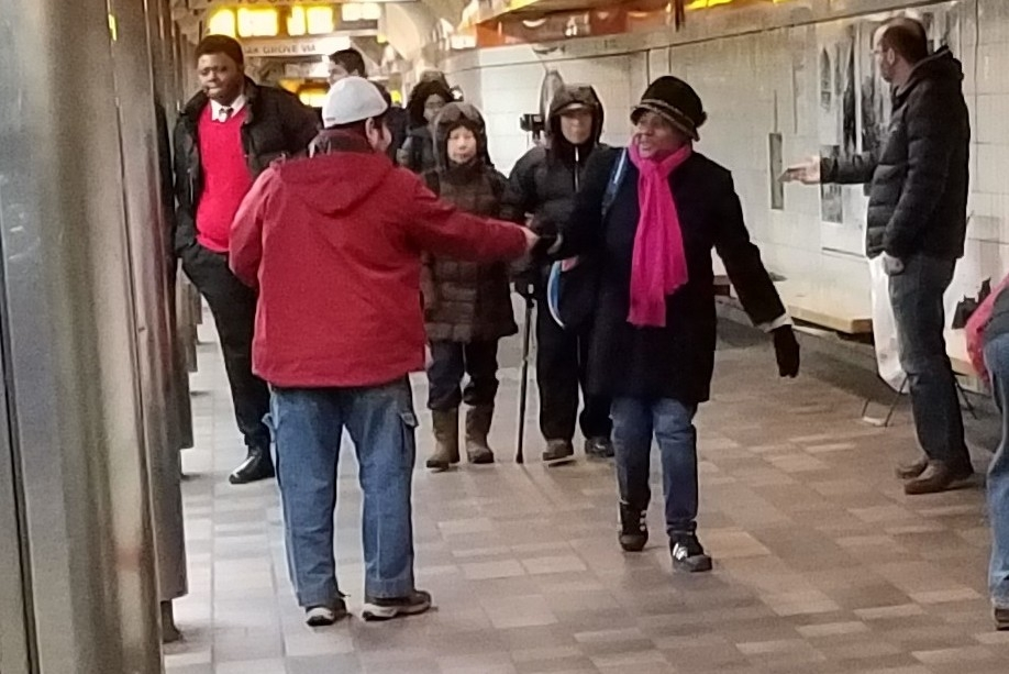 When one of the other trains down the hall pulls in, it sends a flood of people down our way. So many of them take gospel booklets. It's tremendous!