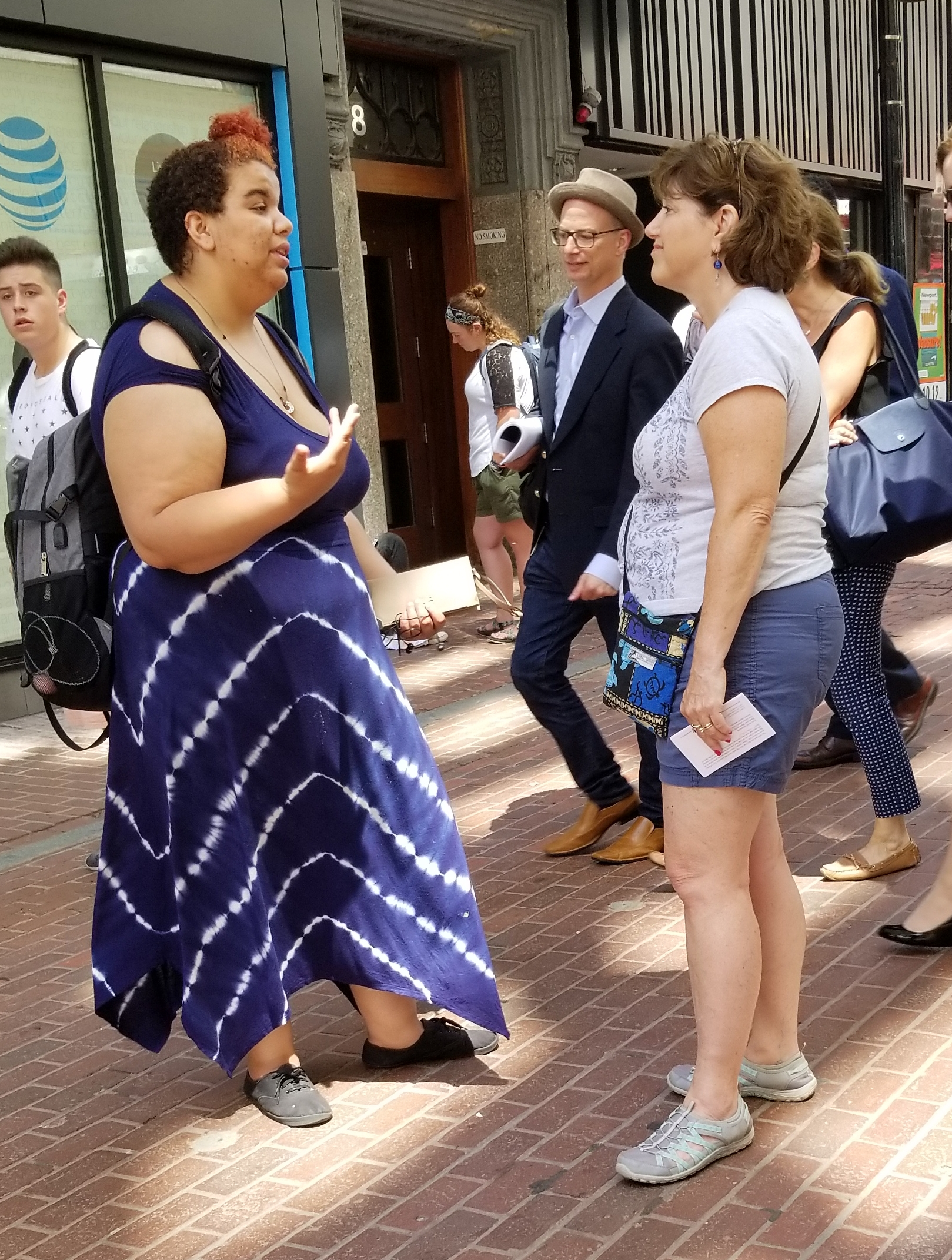 Audrey reasoning with a woman in Downtown Boston. Do strangers really stop to talk to us? Oh yes they do!