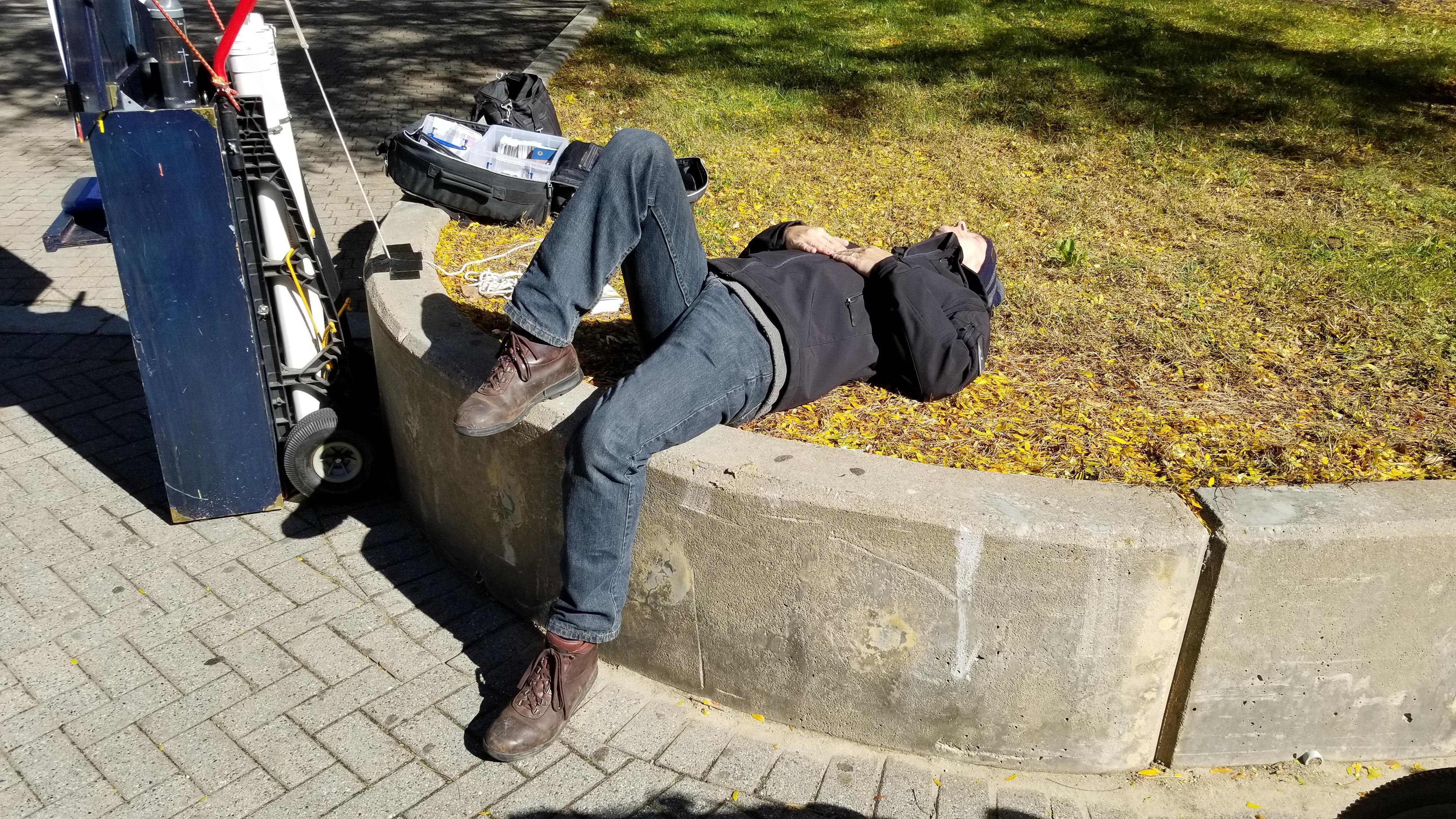 Think evangelism isn't tiring work? I caught Chris laying down on the job! LOL