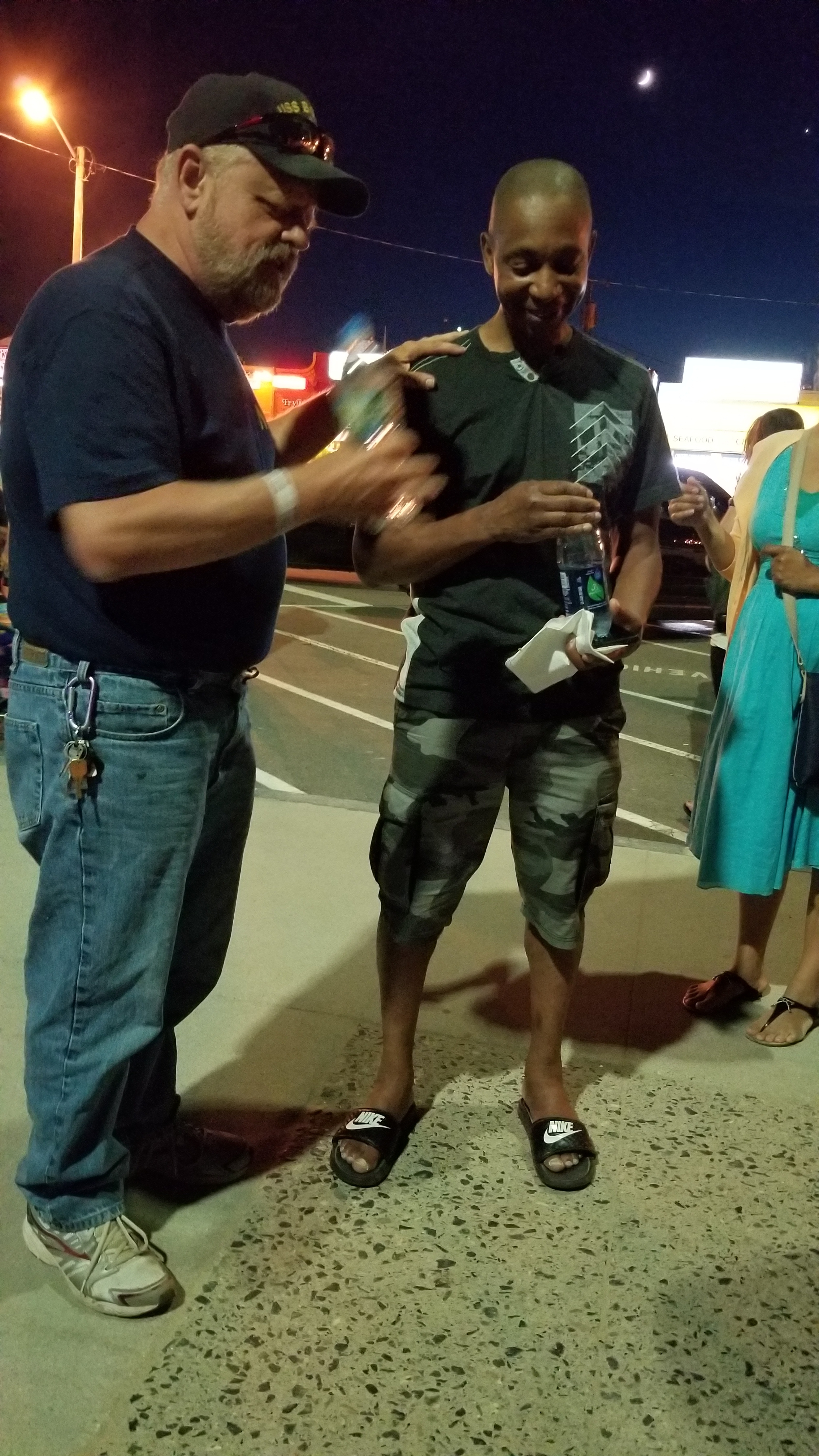 This is J.R. (right). He was heckling me and was clearly angry with Jesus. I answered a number of J.R.'s objections, but he still balked. So I asked him, 'J.R. if I could answer every single objection you pose and you really believed that Jesus is Lord, would you worship Him?' And J.R. said no. So I answered, 'there's your problem. It's not a lack of evidence that is holding you back, but that you just don't want to worship Jesus. It's pride.' Then Mike (left), a complete stranger to me, who was overhearing the conversation,  came and asked to pray for J.R. on the spot. That's really cool!