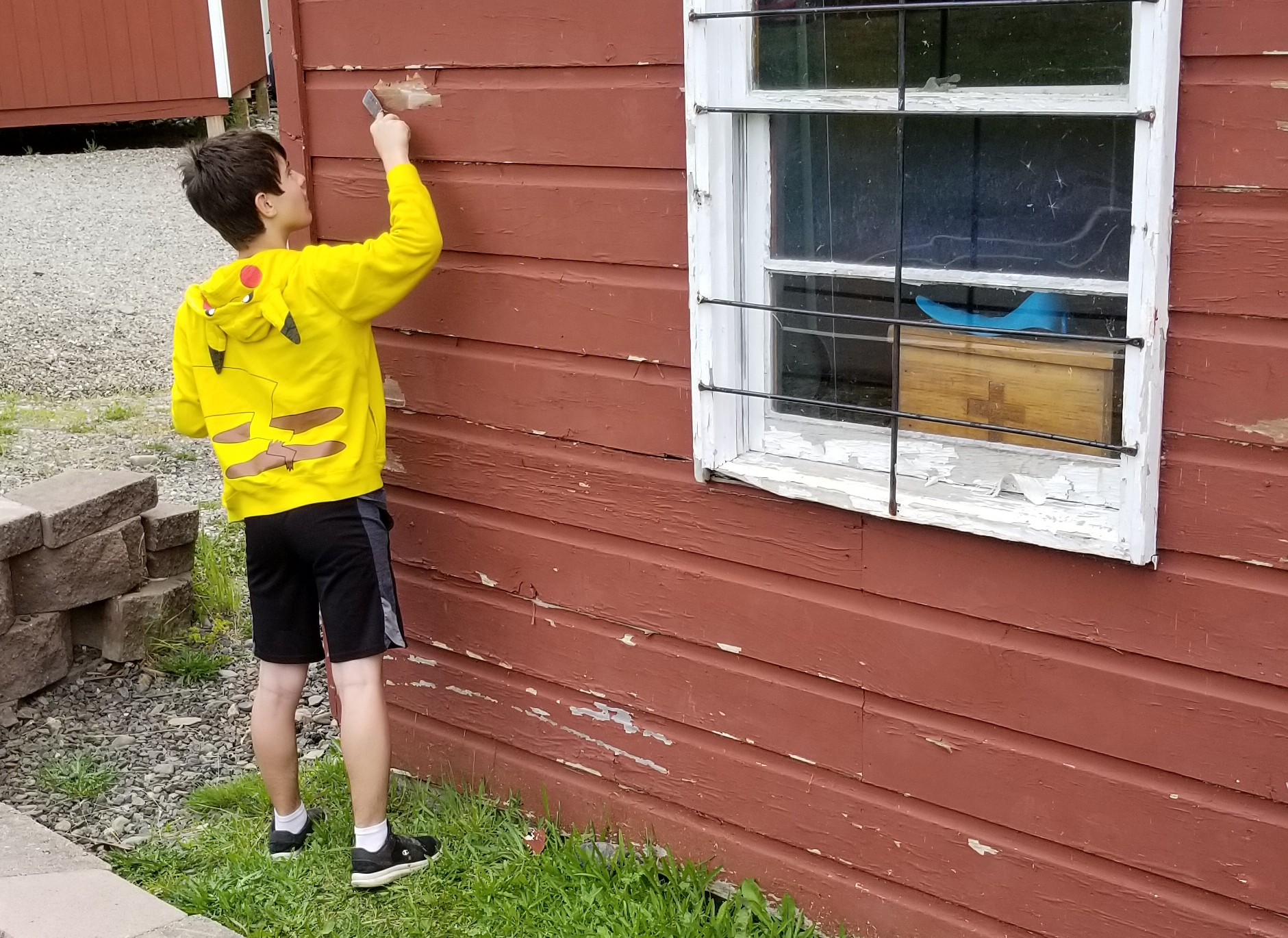 Caleb did a GREAT job as a Staff Boy. He scraped paint, re-painted buildings, mowed lawns, collected trash, moved bails of hay, helped move a fallen tree, and whatever else needed done around the camp. Way to go Caleb!