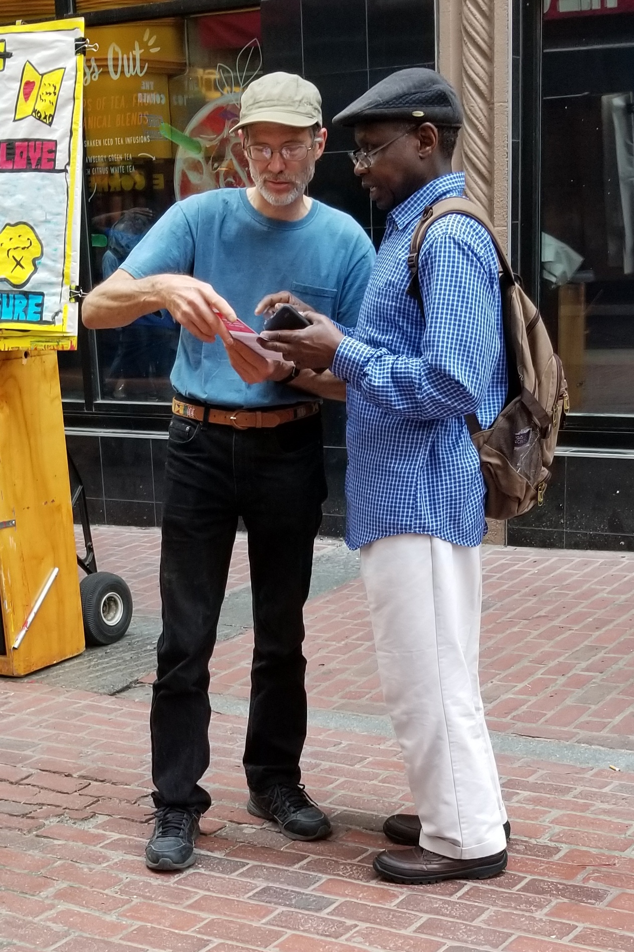 Bruce walking a man through a gospel booklet.