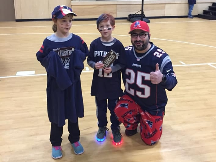 The winners of the 'Best Dressed for the Patriots Superbowl' contest from the beginners group. They each got a gigantic chocolate bar!