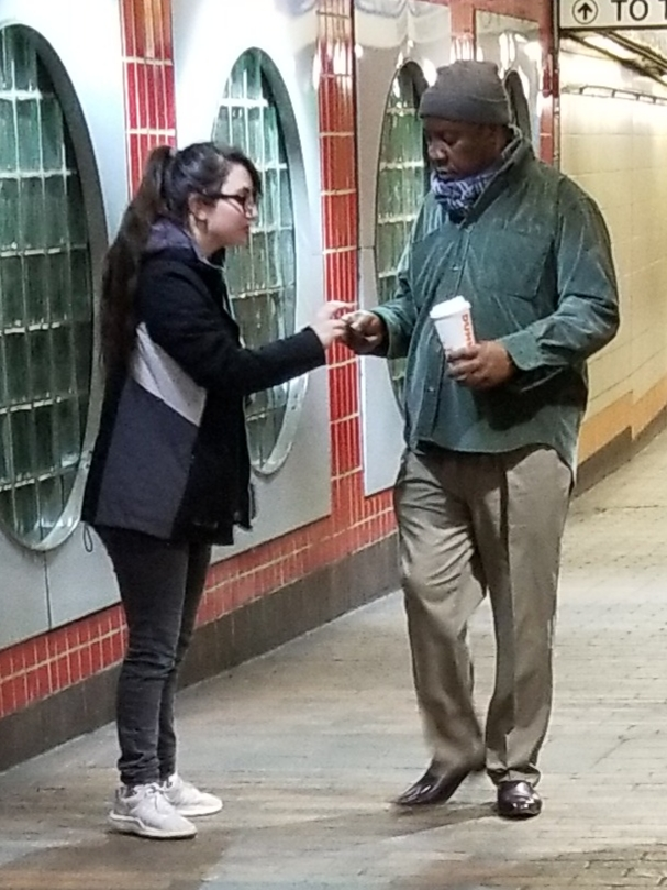 A man taking a tract from E.