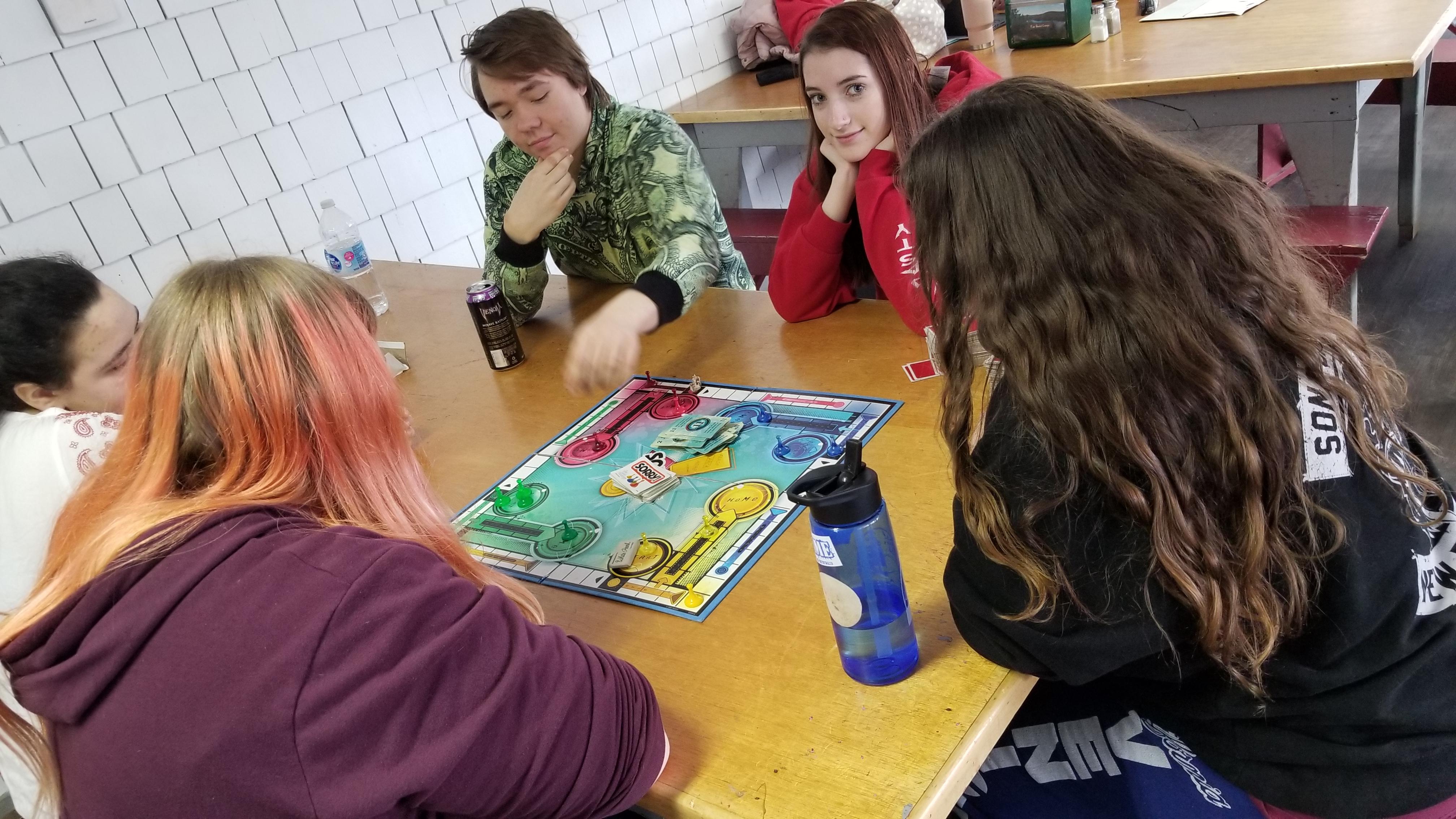 Teens playing games at night.