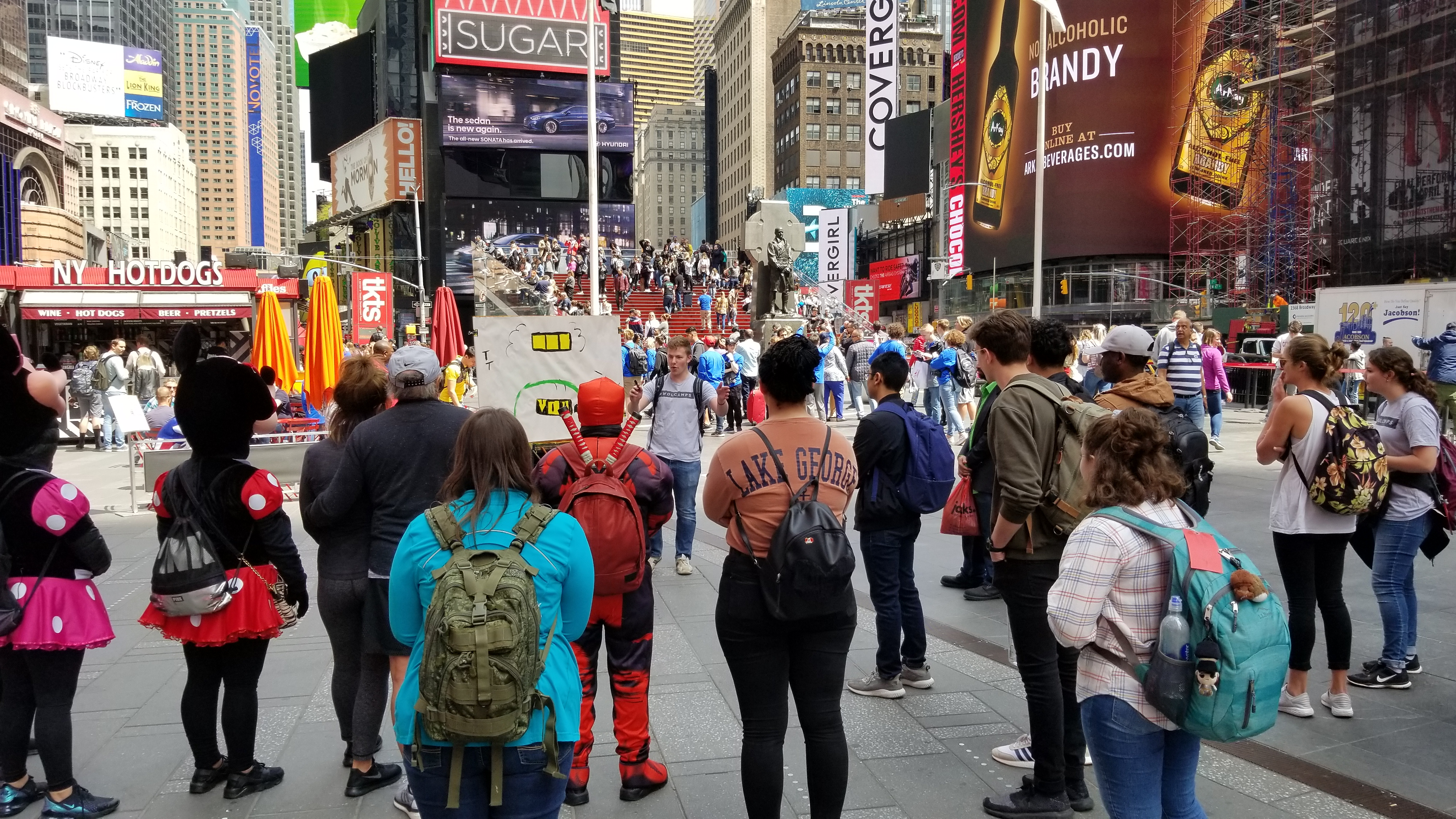 You don't see this everyday. Ben is preaching the gospel in Times Square, and 2 Mini Mouses and 1 Deadpool is listening (and a bunch of regular humans too).