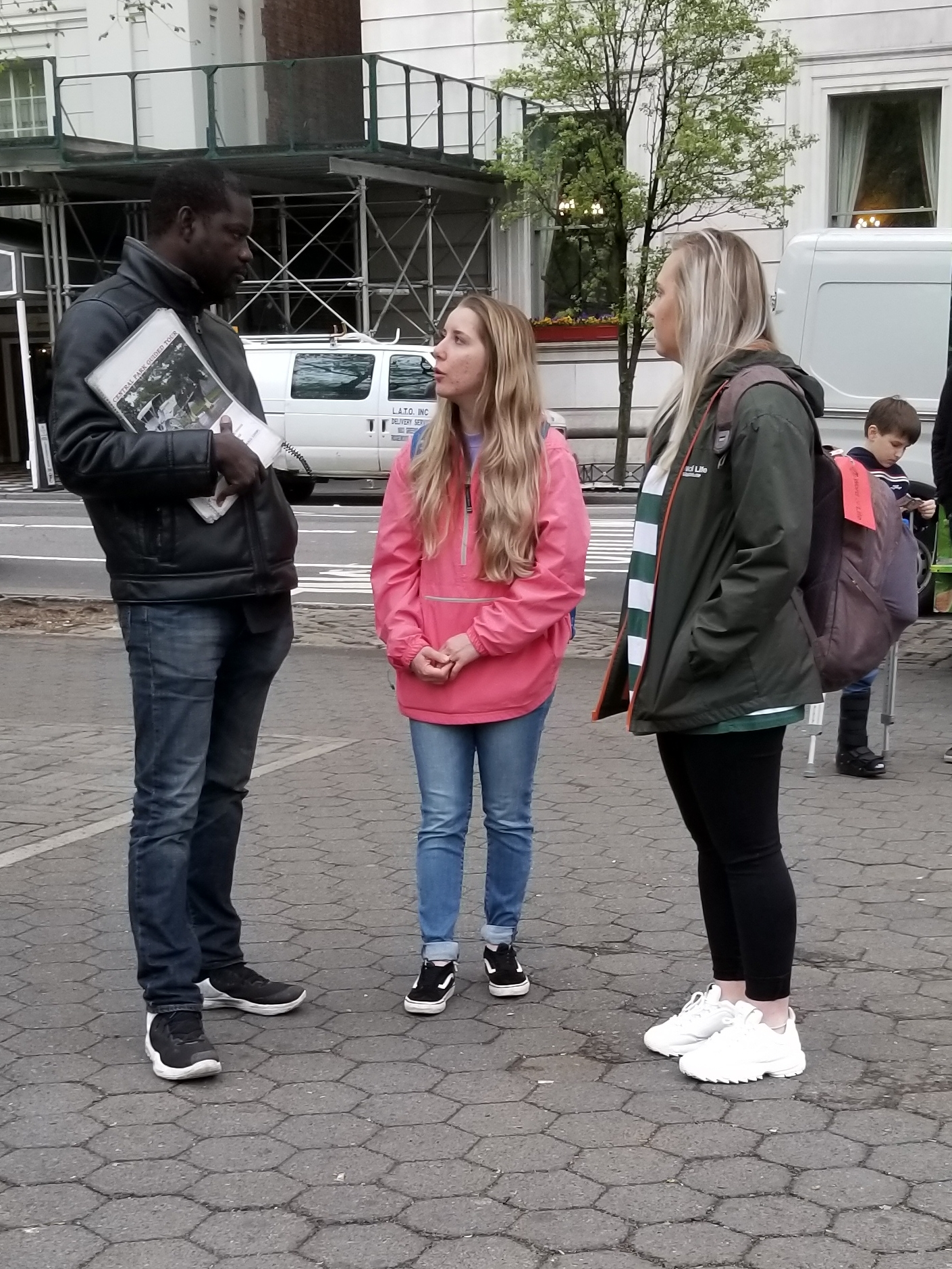 Natalie and RJ spoke to a man selling newspapers on the street. Bold as 2 lionesses!