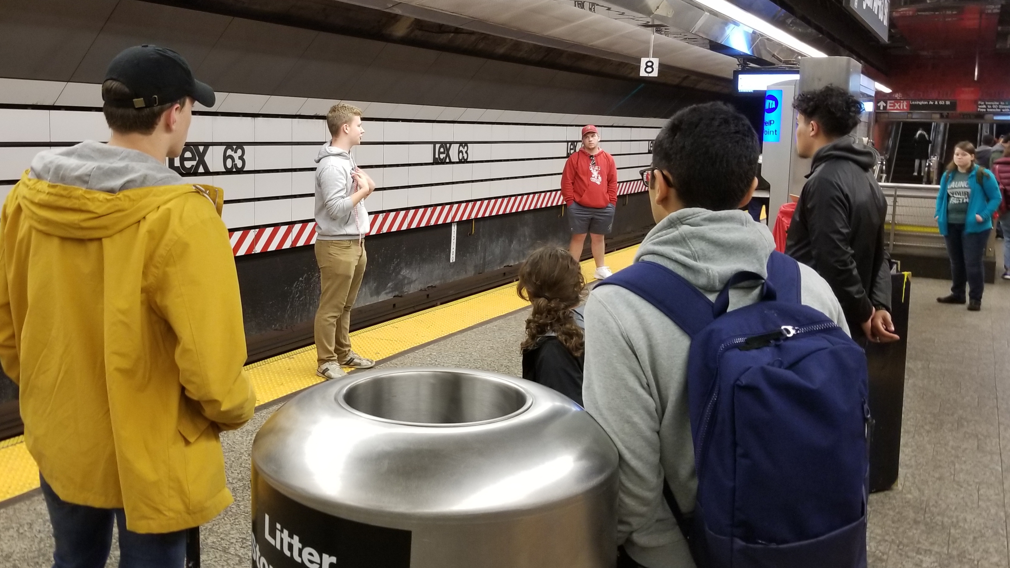 When it began raining, we headed down into the subway. God gave us a terrific ministry spot down there. We were able to do a dozen or so open-air messages, like this one Ben is doing.