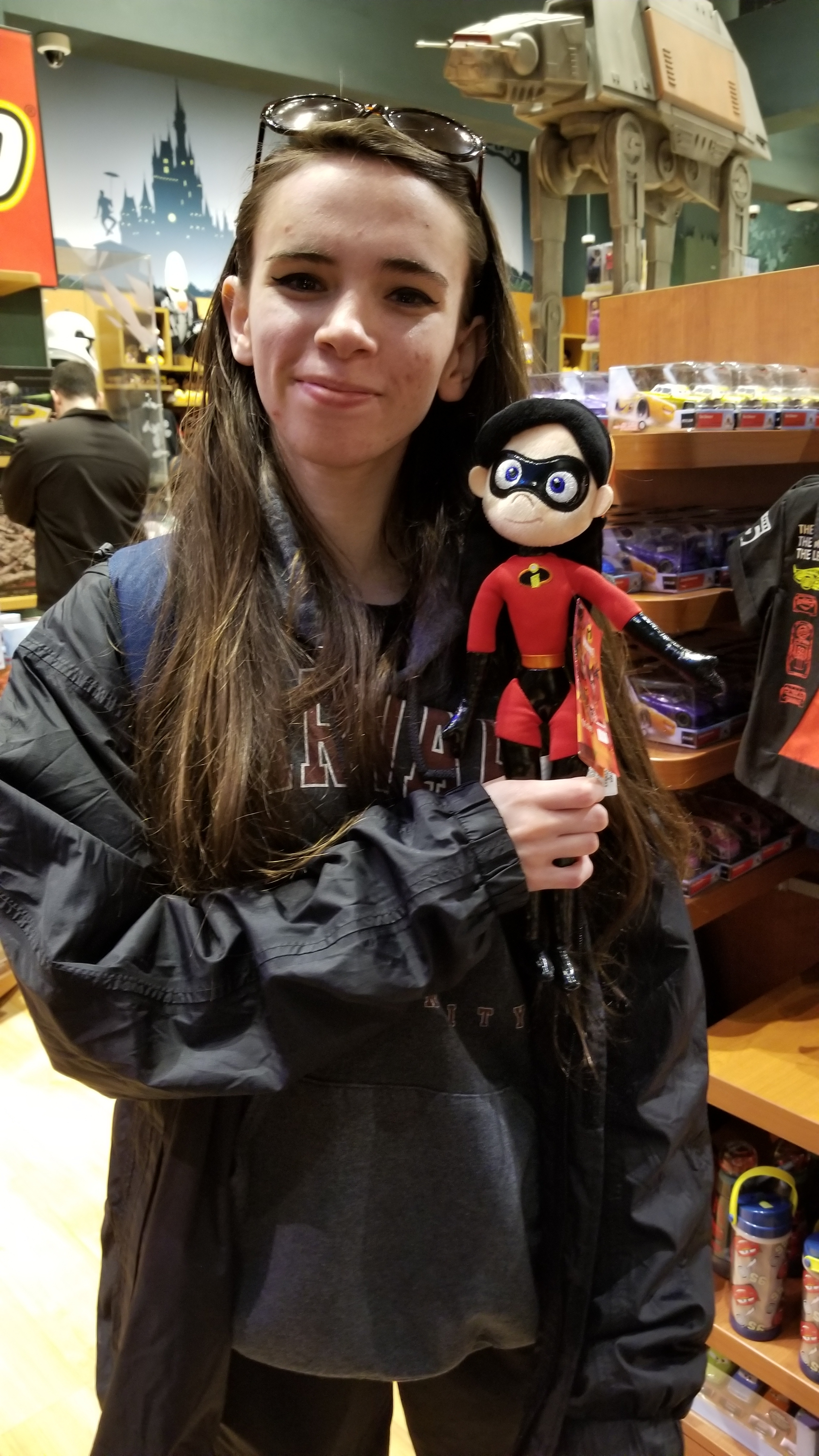 A lot of us thought that Christina here looks like Violet from 'The Incredibles.' So we found a Violet doll. Do you see a resemblance?