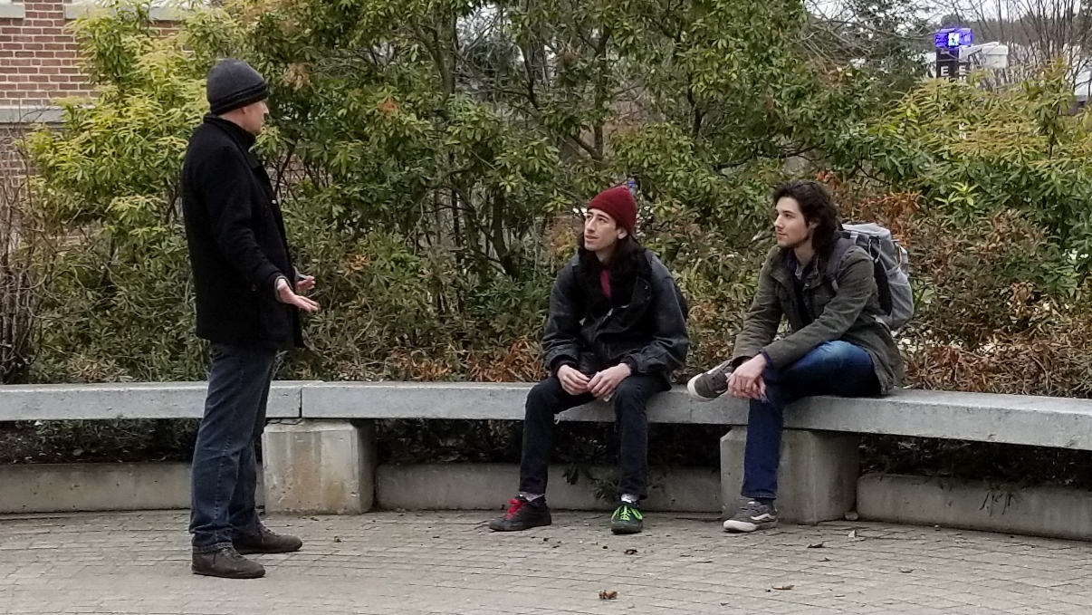 """This is Michael and Julian. They're both Philosophy Majors. They said they'd find out if there's a Heaven when they get there. Chris took them through """"The Good Person Test"""" and that yielded good fruit. They each took an Evangelistic DVD."""