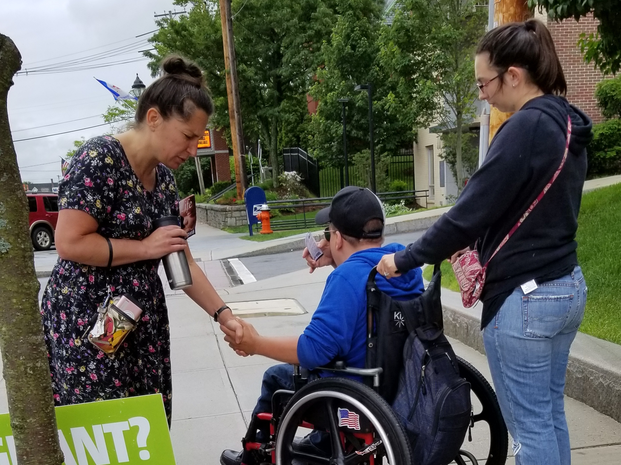 "This is Wayne, a disabled man with a slight speech impediment and in a wheelchair. He was so glad we were outside the abortion clinic standing for life. He gave testimony of his faith in Jesus Christ!  As he was leaving, he asked if Christine would pray for him. In this photo she's doing just that.  After Wayne left, I turned to the five abortion center employees and said to them, ""So many of the babies you destroy have their lives ended because they're going to be disabled. They might need a wheelchair. They might need a caregiver. Instead you 'fix the problem' by violently murdering them.""  I told them, ""You saw Wayne. He's happy. He's glad to be alive. He's human and he has dignity and you kill tons of Waynes all the time. I hope you got a good look at this remarkable man, because you kill so many just like him. It's barbaric and you're using violence instead of caring for those who need help. How can you live with yourselves for killing those like Wayne? Why is his life less valuable than others?""  They wouldn't answer me. Honestly, they can't. Abortion is using violence to get rid of someone to try to solve a problem.  Please understand that I don't normally speak so firmly. I never speak so firmly to the Moms. But these weren't Moms. These were abortion clinic workers, so an extra bit of firmness was appropriate in this case.  Why is Wayne, with a disability, less human than others? He isn't! He's created in God's image and has worth whether he can walk or not.  And the abortion workers have worth too, so please join me in praying that God will use Wayne to open their consciences to get them to repent, trust Jesus, and leave their evil work."