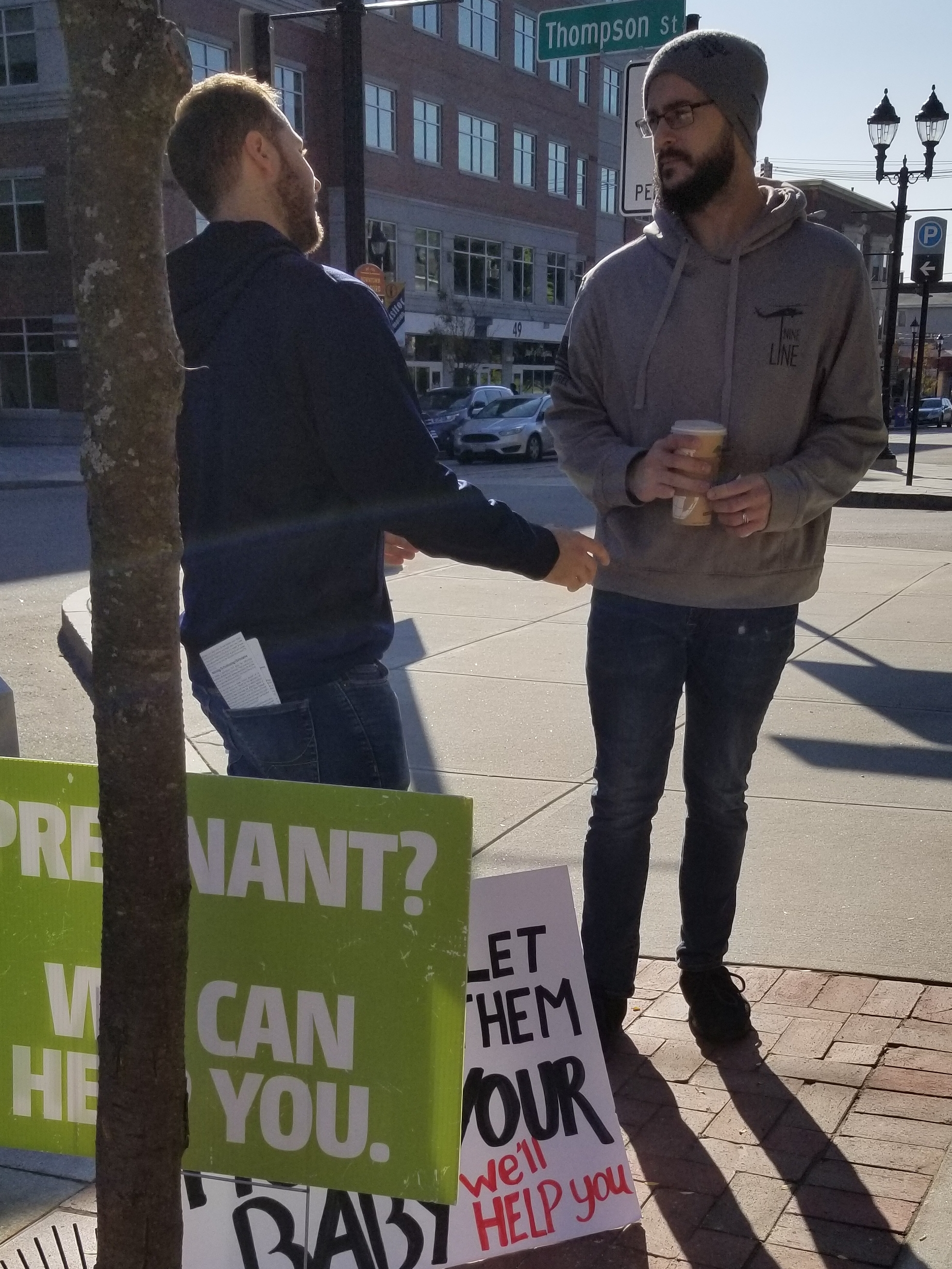 This man (right) walked by us in front of the abortion clinic and encouraged us to stand against abortion.  We're happy when people are against abortion, but we're MUCH more concerned that people are saved Born-Again believers. Michael got to talk to this man about the claims of Jesus and gave him much to think about.