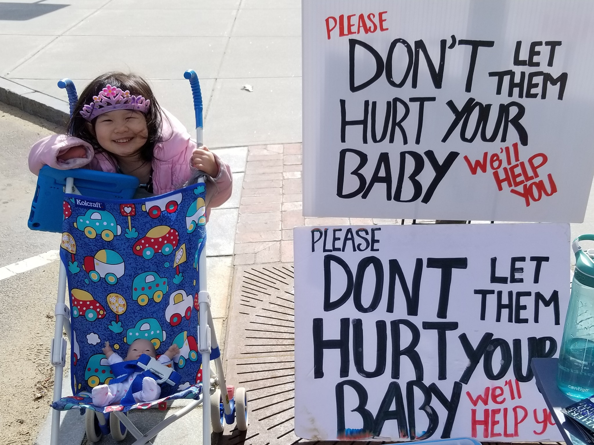 "This is 4-year-old ""G"" and she joined us on the Frontline outside the abortion clinic. She smiled and giggled often and brought light to a very dark place.  Her Dad, Kyle, explained to the Clinic Escorts that he adopted her from China and that she has a missing/disfigured right hand.  He said, ""You would be willing to abort a baby for that. Why shouldn't this child be alive?""  They looked coldly at him and at ""G"" and said, ""That's the choice of the Mother.""  Are these the people who should be counseling scared and vulnerable pregnant women?  ""G"" is not a ""choice"" to be kept or discarded by someone's will. She's a real living human being who deserves life. And she's living proof that adoption works!   You know who else deserves life? All the unborn Babies who die at this clinic. Please pray that God changes the hearts of the workers of this place."