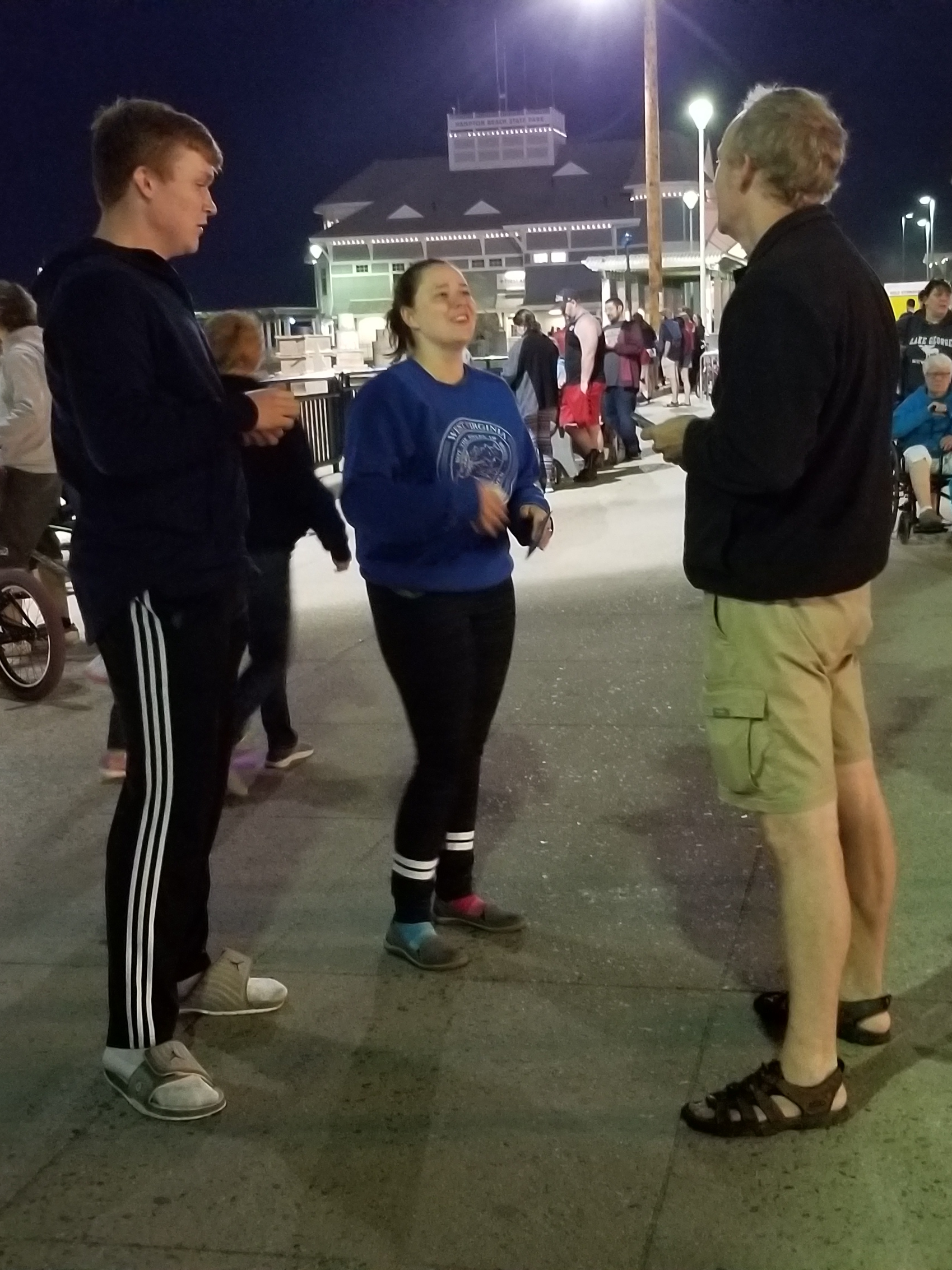 """Chris talking with two young students with Campus Crusade for Christ. They watched us for a while to see if it """"really works"""" to talk to strangers about Jesus. They were happy to have run into us. We encouraged one another in the faith!"""