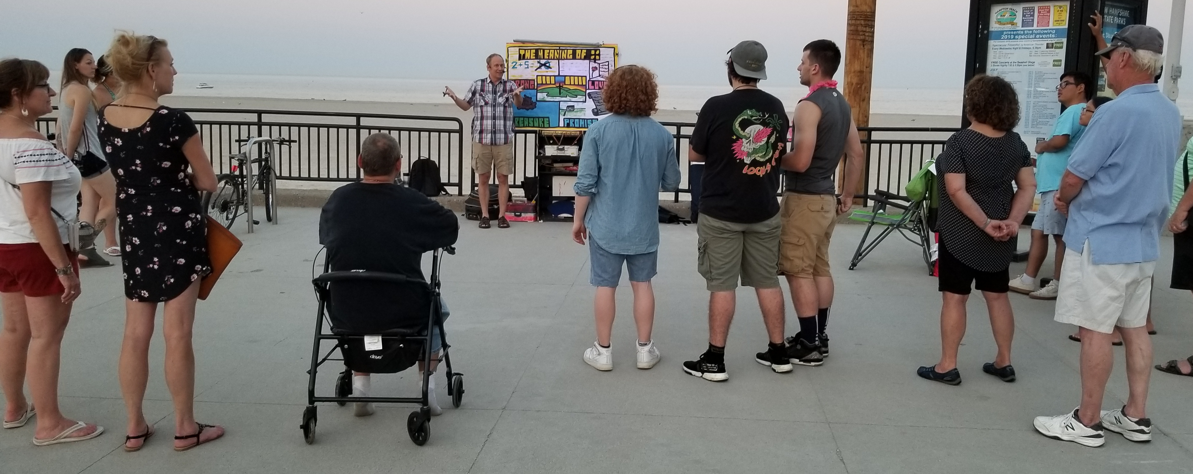 Chris giving an Open Air message. The man in the chair is George. He listened to the whole message and spoke with Chris afterward. More on that encounter in the photo below...