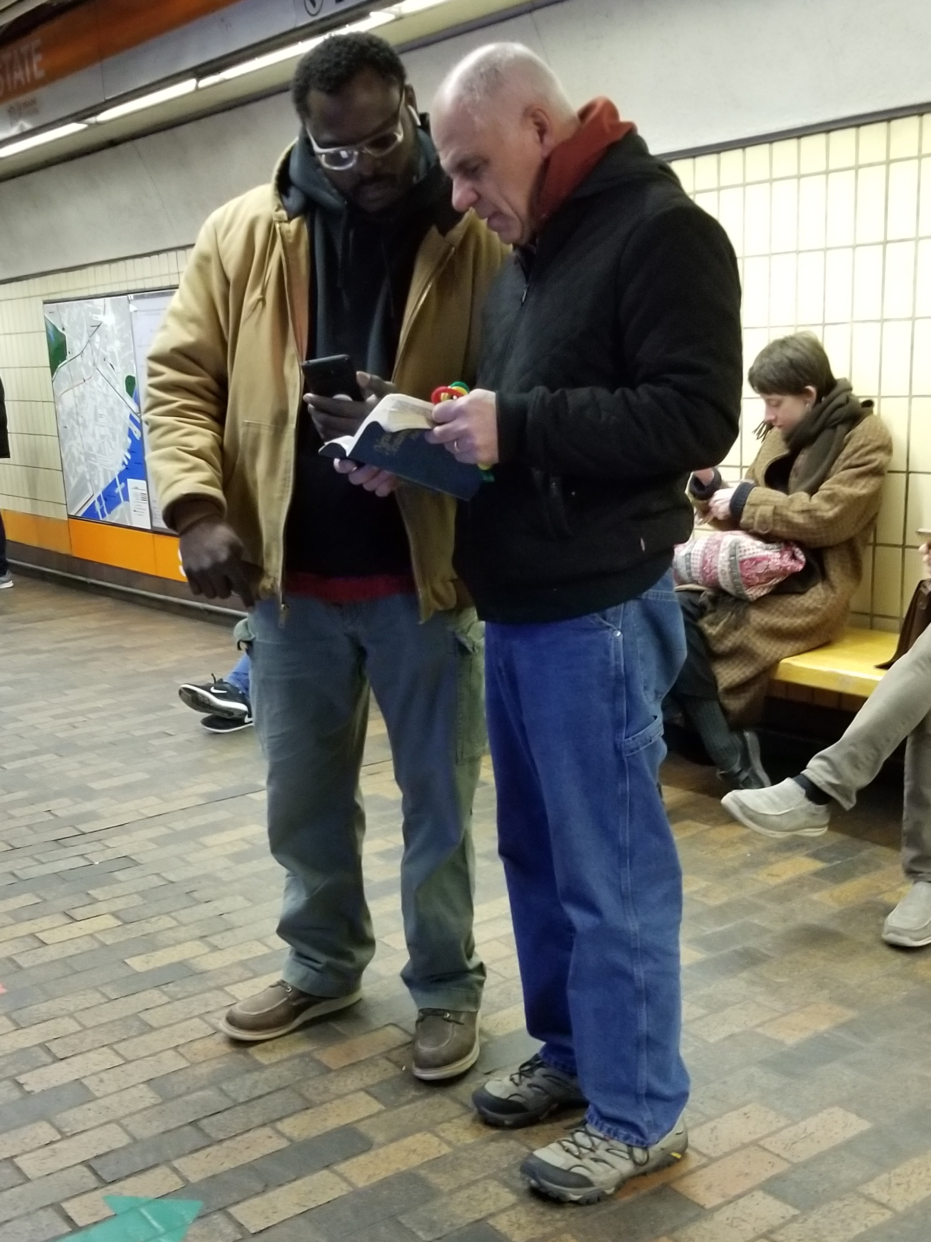 """Remember Dowuda, the Black Israelite who was so disruptive? The next week we ran into him AGAIN! At first he was civil, asking Eric to look up Bible verses. But that didn't last long. He began YELLING to the crowd that Eric is a paedophile. I tried to reason with him that it's not godly or even polite to make such a charge with no evidence, and he called me a """"Fake Jew"""" and YELLED to everyone that I'm a paedophile too. He YELLED that Jesus was black, and Moses was black. And he told us to read the King James Bible only, and that King James was black. (Uhm, we have paintings of him - he wasn't black.) Sadly, this is what Black Hebrew Israelites are taught to do. They yell and swear and use disgusting name calling. Please pray for Dowuda, that he'll know the true love of Christ. And to learn more about his beliefs, https://carm.org/black-hebrew-israelites."""