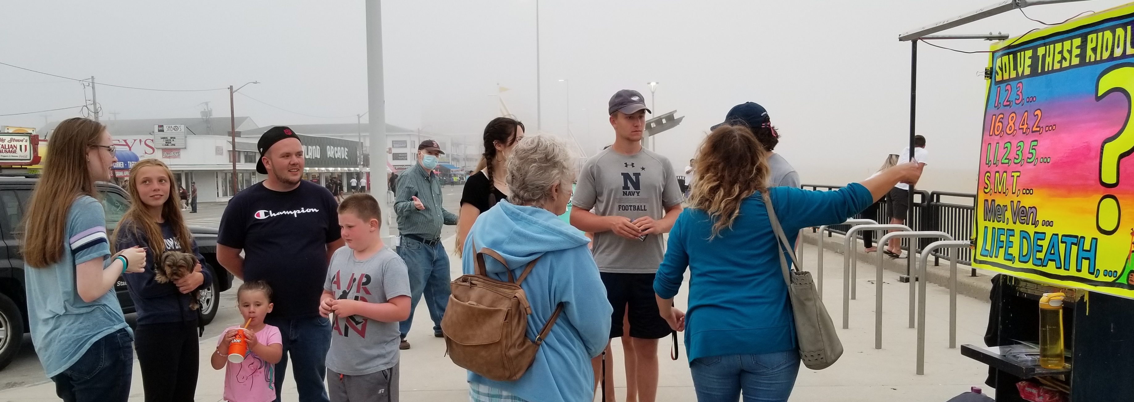 "This is called ""Triple Evangelism."" Faith is sharing Jesus with a family on the left. Terry and Patrice are talking with a family on the right. And if you look in the back, Wayne is sharing Jesus there.   This is NOT uncommon at the beach!"